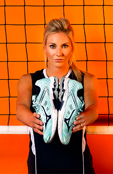 An athlete using Mizuno Volleyball gear