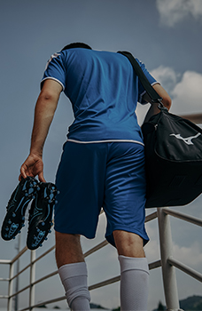 An athlete using Mizuno football gear