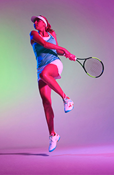 An athlete using Mizuno tennis gear