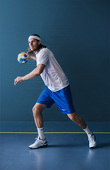 An athlete using Mizuno handball gear